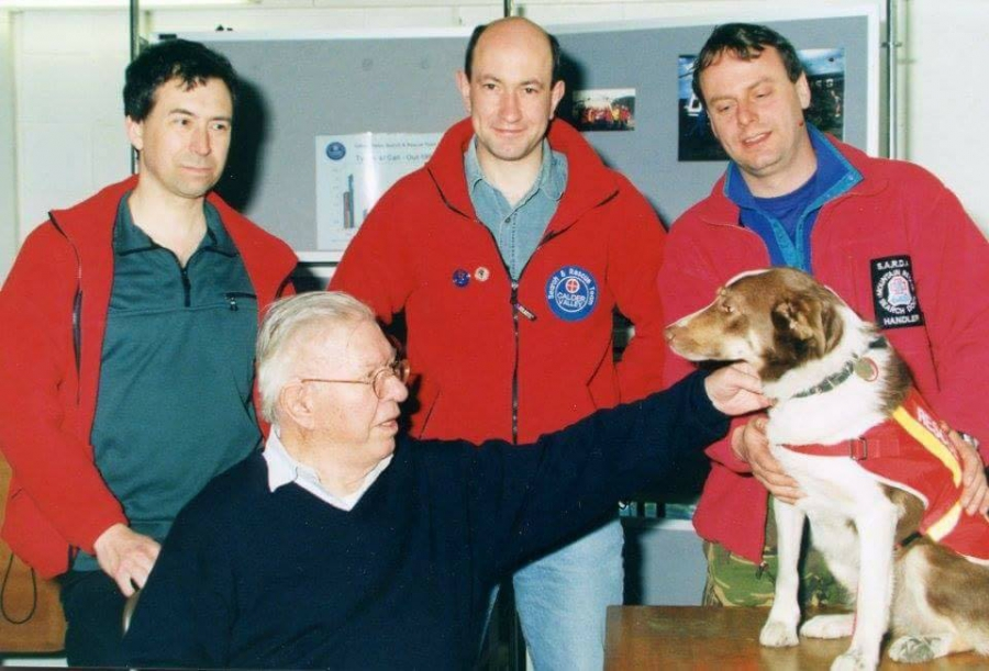 CVSRT Martin Woodhead (middle) with Dr Andy Simmons (L), Sir Fred Hoyle (seated), Simon Adams (R) and Search Dog Tip